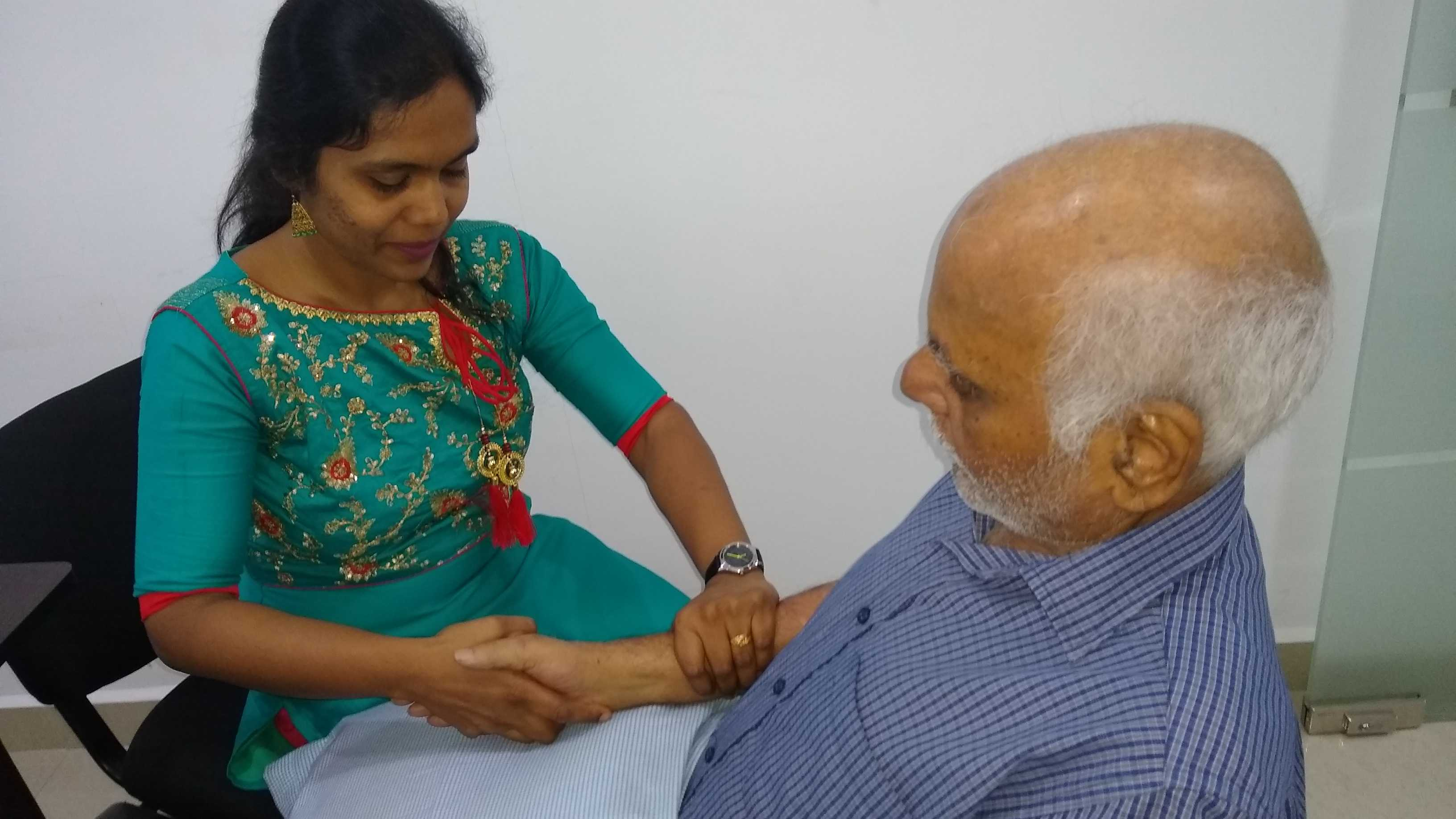 Occupational therapist treating patient